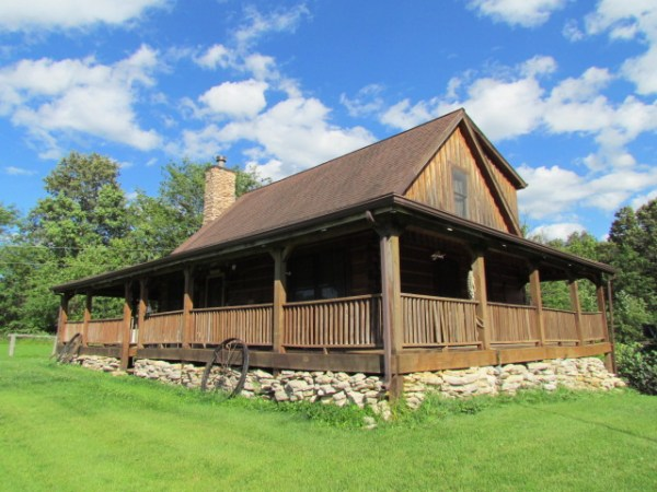 Beautiful Log Home With Acreage